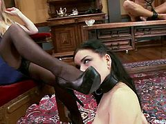 Two kinky chicks lick each others pussies to make their mistress horny. After that they toy each others pussies with a double dong.