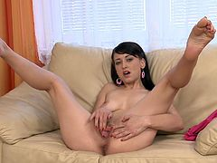 Watch this beautiful chick show off her sweet-ass body for the camera and finger her lovely pussy between her tight legs!