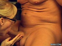 Sexy milf Nina Hartley likes posing in sexy pantyhose while receiving huge cock through them