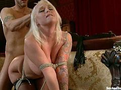 Curvy blonde Angel Vain and insatiable Derrick Pierce are having some good time together. Derrick ties the chick up and spanks her ass before destroying her cooch doggy style.
