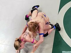 Bella Wilde and Lea Lexis show their fighting and wrestling skills in a ring. After that the losing girl gets toyed deep and hard.