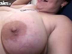 Provocative granny seduces the guy for sex. The latter is a big fan of ink art so he is covered with tats all over. Granny takes off her clothes showing her fat ass and fatty belly. She sits on a couch spreading her legs. The guy eats her snatch and drills the hole with huge dildo.
