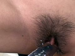 She is slutty bitch with athletic body. She is going kinky and dirty in a gym letting the guy play with her snatch using the toy. Suzu cums producing much juice.