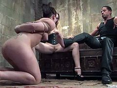 Petite brunette girl gets whipped and then tied up by kinky blonde mistress. Then the brunette sucks a cock and licks blonde's pussy.