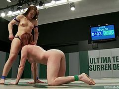 Cheyenne Jewel and Odile are having a battle on a ring. Then the winner takes a strapon and fucks the loser's hot cunt with it.