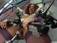 The naughty red-haired vixen Daisy Ducati is going to be fucked by several sex toys at the same time in this wicked clip.