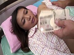 Busty Japanese milf lies on the bed in lacy white panties while a kinky daddy stretches her brownish shaved vagina with his fingers and later tongue fucks it with pleasure.