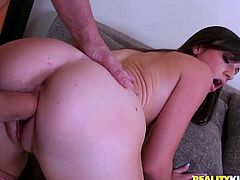 Adorable brunette girl gets her wet pussy fingered. After that she sucks a cock and gets fucked on a sofa. She also gets her pretty face covered with cum.