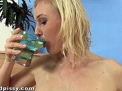 Milky white skin, boobs that you'll love to lick & suck and a wet pussy that's getting wetter from all that piss. Sherry lays naked on the floor and fucks herself with a sex toy until she has enough and wants to piss. She collects the urine in a cup and then drinks it!