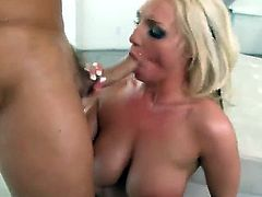 Long haired blonde bombshell Sadie Swede with big fake tits and round bouncing ass in high heels only gets her face fucked rough by her randy lover with shaved head.