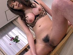 Luscious brunette babe with big natural boobs is hell seductive bitch. She squeezes her tits showing them close-up. Then she reveal wet hairy snatch pulling down the bottom of outright bikini. Akari inserts her favorite sex toy in the slit pleasing herself.