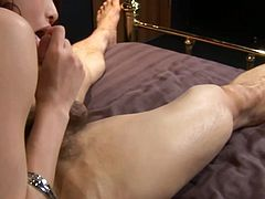 Alluring Japanese babe stands in pose 69 to give a steamy blowjob to kinky dude before he rubs his strain dick between her big milky tits.