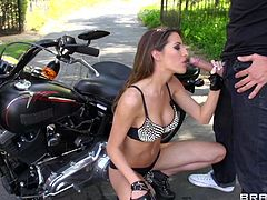 Look at her, this babe was made for fucking and nothing else. She likes big bikes and big cocks so after cleaning this guy's motor Kortney goes down on the dude's dick. First she looks at the big dick with those gorgeous eyes and then sucks it like a pro. She knows what she's doing so keep on watching!