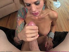 Sexy blonde milf Sarah Jessie strips and shows her awesome body to the guy. Then she gets on her knees in front of him and drives him crazy with a terrific blowjob.