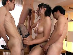 Filthy Japanese chic in black lingerie and fishnet stockings pleases three kinky dudes simultaneously. She gives them blowjob in turns while getting pounded in turns in gangbang sex video by Jav HD.