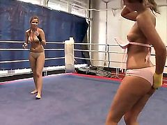 Pretty young brunette babes Debbie White and Peaches with natural boobies and nice asses in bikinis get filmed in close up while having arousing chick fight in the ring.