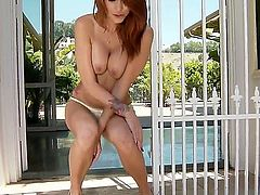 Redhead woman with luxurious body Monique Alexander is solo masturbating. The cutie is staying bare showing all of her delights before fingering and dildoing twat.