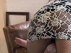 Natsumi Shiraishi is wearing sexy fishnets and she lays back on the couch in the living room. She lifts up her legs ever so slightly so you can get a peek at her panties. She gives her partner a blowjob and another guy joins in and kisses her ass.