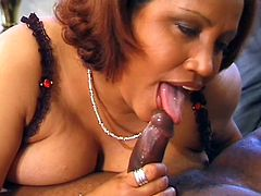 This fat ebony couple are getting ready to watch a porn movie. She pulls out her husband's cock and begins to give him a blowjob. Watch as she rubs his balls while she does this. She climbs on top of him and rides him.