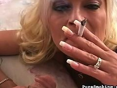 Sweet blonde enjoys naughty fetish of smoking while sucking huge dick