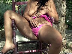 Busty European hottie Giovana masturbating outdoors