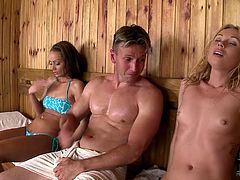 Lustful bitches with killer bodies are having fun in sauna. They seduce a single guy for a passionate threesome sex. She surely doesn't mind fucking them both. So check out how it goes.