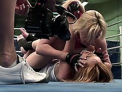 Two aroused blonde pornstars Nikita and Tanya Tate enjoy in revealing each others naked body as they wrestle in the gym in the ring and play with each others pussy