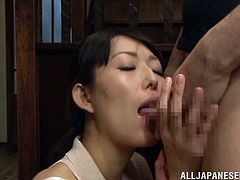 She's a Nippon mature with a crave for cock. The whore stays on her knees and licks the guy's balls and cock with great pleasure before putting that penis inside her mouth. She loves the taste and feeling of a penis between her lips and maybe she will even receive some semen too