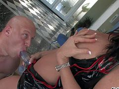 Dominant and busty brunette pornstar babe Raquel Devine enjoys in using her rubber dildo and slammig horny Christian xxx with it in bedroom while hes on his knees