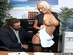 Busty blonde babe Lichelle Marie is having a good time with some horny man in an office. She lets him eat her shaved coochie and then they bang arently on a desk.