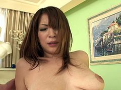 She is curvy Japanese mom with feisty sexual energy. She is sucking cock while the other guy is boffing her cooch from behind. Finally, she is riding the shaft like crazy.