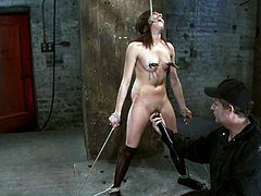 Stunning babe takes her clothes off and gets tied up. After that she gets her hot pussy toyed and fingered. She also gets her tits clothespinned.