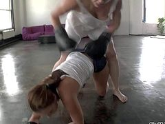 Adrianna Nicole and Ashli Orion enjoy in taking on each other, wrestling, stripping and licking on the floor in an abandoned building and have fun in lesbian sex session