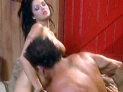 Fabulous brunette babe with huge tits opens her legs and big guy eats her shaved pussy! Then she lets him bang her hard in doggy style.