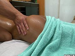 Bronze skinned busty sexy Sadie Santana gets her perfect bare ass massaged. Skillful masseur turns her on and then she takes his white sausage in her mouth. Watch her suck after massage session of her lifetime.