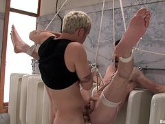 Watch this guy being tortured by her gay professor in this bondage video where he's forced to suck and fuck his hard cock.