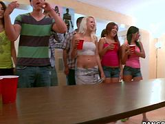 Topples pornstars Abbey Brooks, Jamie Valentine and Nikki Delano show their massive boobs to everyone in the college dorm at a party. Thee play games and suck guys dick in public.