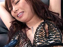 Fuckable Japanese harlow lies on her back with legs spread aside while getting her bearded vagina teased with sex toys through a hole in her pantyhose in sultry sex video by Jav HD.