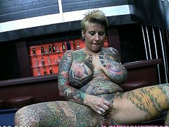 Nasty MILF with huge boobs shows her tattooed body. She gives a titjob and also sucks a cock. After that she gets fucked and facialed in POV video.