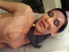 Tempting raven haired hottie named Thalia passionately fingers her pink twat and pokes it with thick plastic dildo. She lies on her back and gets her cunt treated with milk enema.