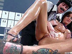 Hot ass and arousing brunette pornstar Gia Dimarco with tattoo on her back enjoys in getting a hot and arousing massage from a dirty cop Johnny Sins on the desk in his office