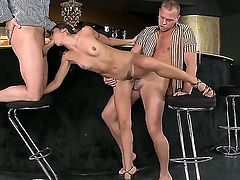 Slender black haired Lou Charmelle with natural boobs and dark heavy make up gets fucked in tight ass while having mouth full with stiff cock in threesome with two handsome studs.
