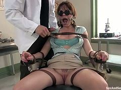 Dana Dearmond is getting naughty with Erik Everhard in a hospital ward. She lets the dude tie her up and then moans loudly when he fucks her pussy deep and hard.