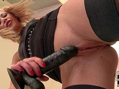 Lindsey Olsen is a naughty Russian blonde in black stockings. She shows her shaved pink snatch as she plays with dildo in front of the camera. She touches her clit and then sticks toy in her hole.