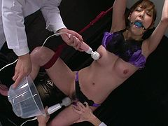 Steamy Japanese babe in steamy satin lingerie gets hanged to the ceiling with mouth plugged with while group of horny doctors tease her cunt and tits with vibrators in sizzling hot sex video by Jav HD.