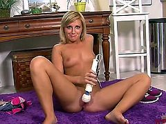 Blonde Nikki Blake with tiny boobs and shaved cunt has fun with dildo