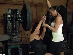 Gorgeous and sexy brunette lesbians enjoy in dominating over each other in turns and have fun in their kinky and arousing sex session with bondage and licking going on