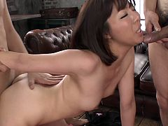 Seductive Japanese milf welcomes two massive cocks for double blowjob before she bends down to get fucked from behind while giving blowjob in sizzling hot MMF sex video by Jav HD.