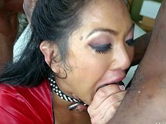 Mya Minx is a raven haired slutty asian woman in sexy red dress. Exotic woman with nice cock sucking experience gets throat fucked by black dude with hard beefy cocks. Watch her swallow meaty dark dicks.