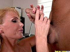 Curvaceous blonde MILF gets her big tits licked and pussy fingered. After that she gives skillful blowjob and gets fucked. She also gets her mouth filled with cum.